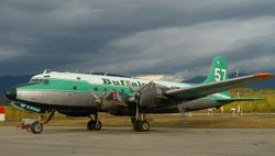The Buffalo Airways DC4 waits on the tarmac ahead of the raid.