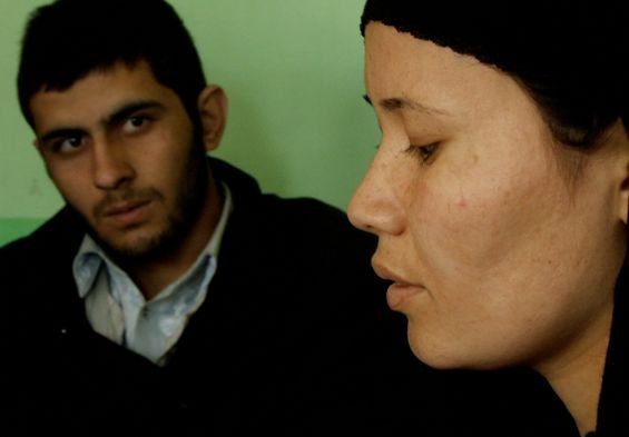 "Image from the documentary ""Love Crimes of Kabul"" which screens on Friday, January 20, 7:00 pm at the Human Rights Watch Film Festival at the Museum of Photographic Arts.  Description: Jailed for running away from home to escape abuse, for allegations of adultery, and other ""moral crimes,"" the women of Afghanistan's Badum Bagh prison band together to fight for their freedom. The film follows three young prisoners as they go to trial, revealing the pressures and paradoxes that women in Afghanistan face today, and the dangerous consequences of refusing to fit into society's norms.  Directed by Tanaz Eshaghian."