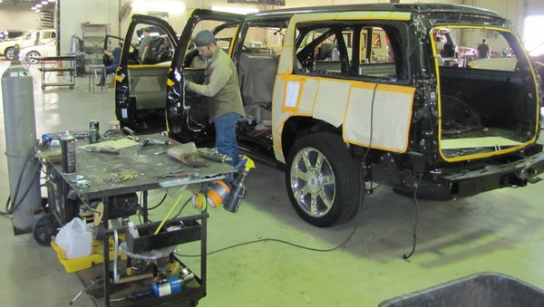 Workers at Texas Armoring Corporation fortify an SUV to withstand an attack from gunmen.