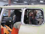 Employees at Texas Armoring Corporation work on the interior of an SUV for a client.