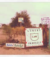 Signs welcoming different clubs to Slab City.