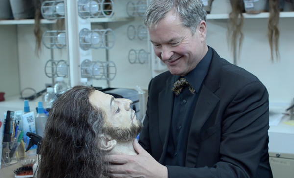 Steven Bryant admiring the prop head of John the Baptist.