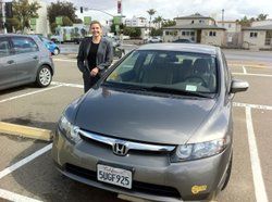 Heather Peters stands next to her Honda Civic Hybrid.