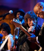 Mick Jagger sings and Buddy Guy plays guitar as President Barack Obama and First Lady Michelle Obama host IN PERFORMANCE AT THE WHITE HOUSE &quot;Red, White and Blues in celebration of blues music in the East Room of the White House, Feb. 21, 2012. The concert is in recognition of Black History Month. In the background, from left, music director and band leader Booker T. Jones, Jeff Beck and Gary Clark Jr. joined in for the song. 