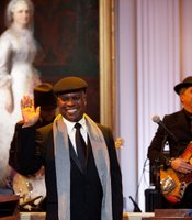 Music director and band leader Booker T. Jones acknowledges his introduction as President Barack Obama and First Lady Michelle Obama host IN PERFORMANCE AT THE WHITE HOUSE &quot;Red, White And Blues&quot; in celebration of Blues music in the East Room of the White House, Feb. 21, 2012.