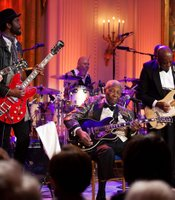 From left, Derek Trucks, Gary Clark Jr., B.B. King, Buddy Guy and Warren Haynes perform as President Barack Obama and First Lady Michelle Obama host IN PERFORMANCE AT THE WHITE HOUSE &quot;Red, White And Blues&quot; in celebration of Blues music in the East Room of the White House, Feb. 21, 2012.