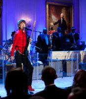 Mick Jagger performs as President Barack Obama and First Lady Michelle Obama host IN PERFORMANCE AT THE WHITE HOUSE &quot;Red, White And Blues&quot; in celebration of blues music in the East Room of the White House, Feb. 21, 2012.