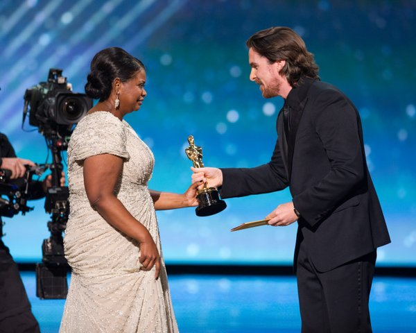 Octavia Spencer accepts her award from Christian Bale.
