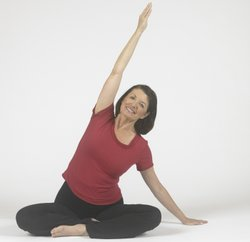 Instructor Peggy Cappy demonstrates a yoga position.