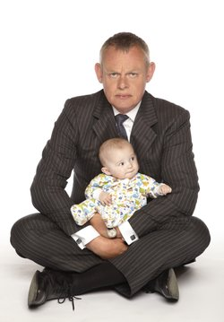 Doc Martin with his baby