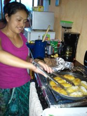 House mother Cecilia González Mendez prepares the food for her Spanish immersion students.