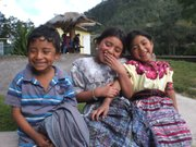 Rural Mayan children waiting for bus to go back to their town from Quetzaltenango.