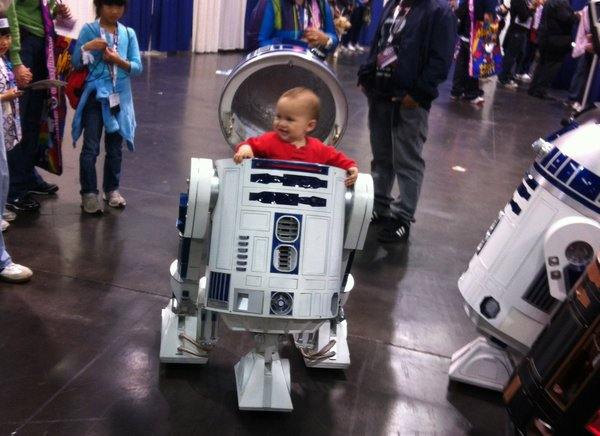 William Miyamoto's child gets to ride inside Dad's R2D2. Lucky kid.