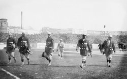 Red Sox players walking on the field at Fenway Park, 1912 World Series.