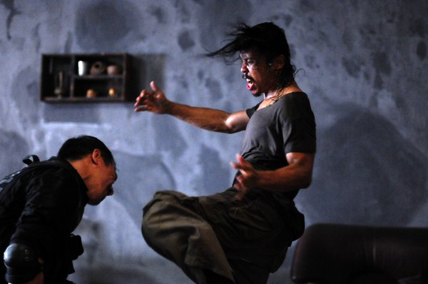 "Joe Taslim as Jaka and Yayan Ruhian as Mad Dog  in ""The Raid."""