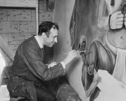 Spanish artist Jose Moya del Pino paints a mural inside the Aztec Brewing Co. rathskeller in 1934. Courtesy of San Diego History Center.