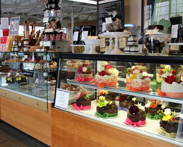A glass case at Extraordinary Desserts showcases the culinary works of art by Karen Krasne.