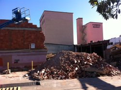 Bulldozers took to the historic Farmer's Market building on Imperial Avenue in San Diego six weeks after Walmart announced it would convert it into one of its stores.