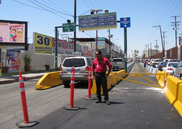 A tourism official stands in front of the new designated medical tourism lane at the Mexicali border crossing.