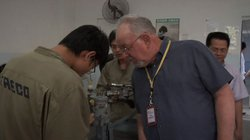 Roy Koch (right) visit with workers at TAECO (Xiamens Aircraft Engineering Company and sister company to HAECO), Xiamen, China. 