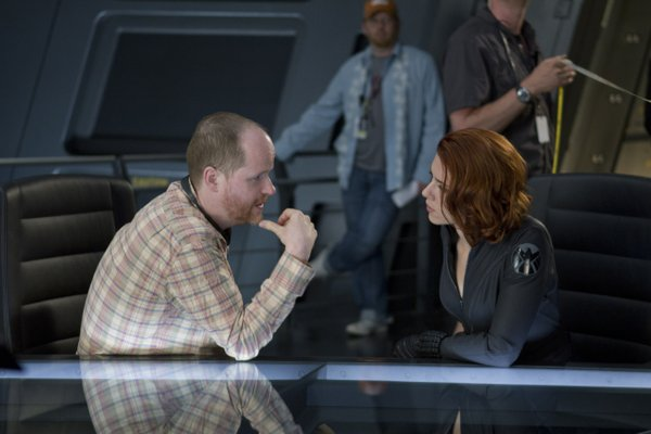 "Mastermind Joss Whedon on the set of ""The Avengers"" with Scarlett Johansson."