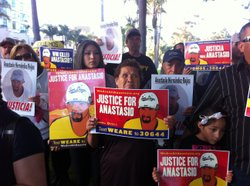 Marchers carry signs bearing the image of Anastasio Hernandez Rojas on Thursday in San Diego. They were demanding an investigation into Rojas&#39; death.