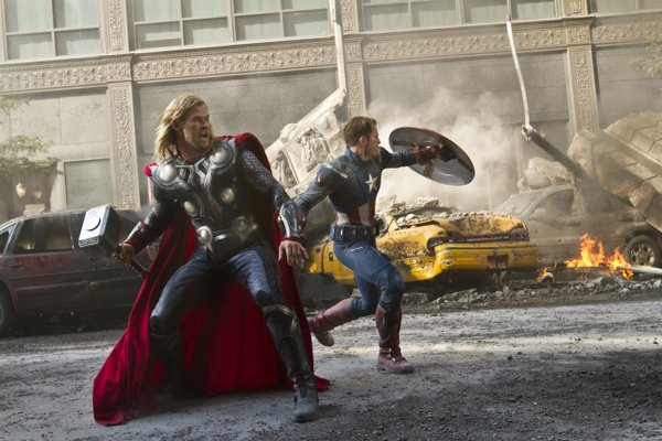 Thor (Chris Hemsworth) and Captain America (Chris Evans) saving the planet in &quot;The Avengers.&quot;