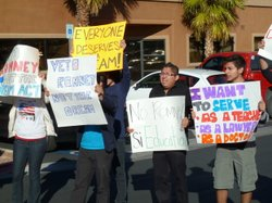 Latinos protest Mitt Romney&#39;s opposition to the Dream Act, outside his campaign headquarters in Las Vegas on Feb 2.