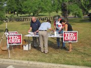Volunteers run an information table about the Ted Cruz campaign at a Tea Party Express national bus tour stop in San Antonio.