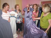 Maren Fuller and her daughters pick out some of their favorite donated dresses.