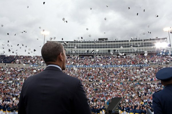 President Barack Obama watches as graduates toss their hats during the United States Air Force Academy commencement ceremony at Falcon Stadium, USAF Academy in Colorado Springs, Colo., May 23, 2012.