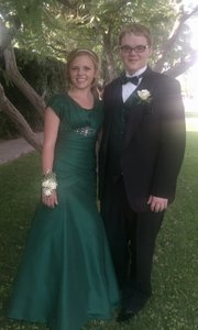Jessica Fuller and her date pose in her front yard on prom night.
