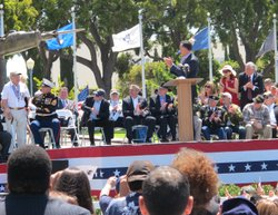 Mitt Romney applauds a local veteran during a Memorial Day ceremony at the Veterans Museum and Memorial Center, May 28, 2012.