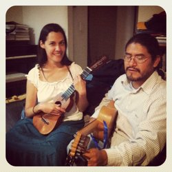 Cindy Cox and Germain Emmanuel tune their jaranas at a recent fandango in San Diego.