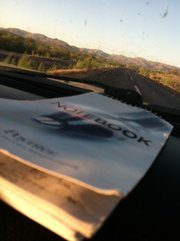 A reporter's notebook and the view of Highway 15 outside of Magdalena, Sonora, Mexico.