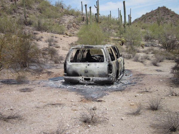 Five bodies were found in this burned-out SUV in the Vekol Valley area of Pinal County.