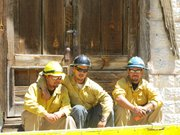 Firefighters in the tiny town of Mogollon, N.M take a break from fighting the Whitewater-Baldy fire in the Gila Wilderness.