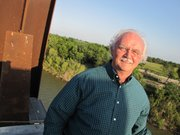 John Wood, a Texas businessman, stands at the edge of an unfinished rail bridge that will link Brownsville, Tex., with Mexico. He's closely watching the Mexican presidential election.