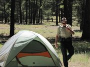 Coconino National Forest patrol captain Jon Nelson checks out a camp, where someone appears to be living in the forest.