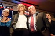 Former Rep. Gabby Giffords celebrates with congressional special election winner Ron Barber on Tuesday in Tucson.