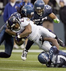 Baltimore Ravens running back Ray Rice is gang tackled by Seattle Seahawks