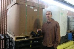 David Bronner, CEO of Dr. Bronner's Magic Soap, stands next to a container of hemp seed oil, which they use in company products. The oil must be imported from Canada because the U.S. doesn't allow cultivation of hemp, because it's related to marijuana.