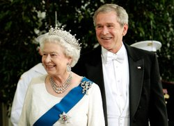 Queen Elizabeth II and President George W. Bush attend a white-tie state dinner given in honor of Her Majesty's visit to Washington, DC.