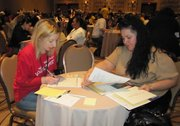 Monica Matisa (right) gets help with her naturalization forms from a volunteer at a <em>Ya Es Hora</em> workshop in February.