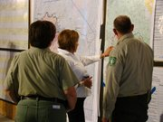 New Mexico Gov. Susana Martinez discusses flood danger in the Gila Wilderness with forest district personnel.