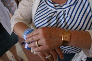 PAN candidate Lolita Montaño adjusts the campaign bracelets she wears on her arm.