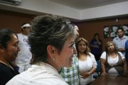 Lolita Montaño bears witness during a civil marriage ceremony in Agua Prieta before starting off her morning's campaign run around Agua Prieta.