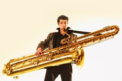 Saxophonist and saxophone collector Blaise Garza with his subcontrabass, the only one in the United States (only four exist in the world; the other three are in Europe).