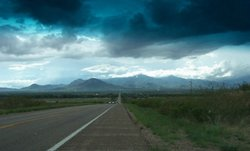 A storm rolls in over the Huachuca Mountains in Cochise County, Ariz. The county shares 83.5 miles of the border with Mexico.