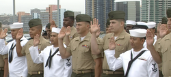 Thirty-five members of the military became U.S. citizens. The all-military naturalization ceremony took place aboard the USS Midway.